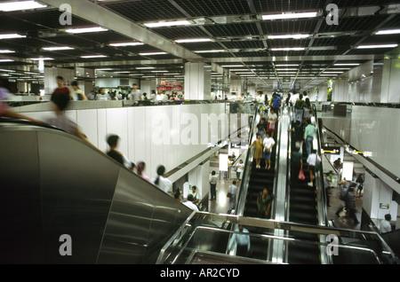 Singapore transport Escalators on the Mass Rapid Transit system - Stock Photo