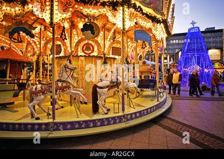 historical carousel on Christmas market in citycenter, Germany, North Rhine-Westphalia, Ruhr Area, Essen - Stock Photo