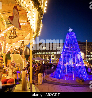 historical carousel and Christmas tree on Christmas market in citycenter, Germany, North Rhine-Westphalia, Ruhr - Stock Photo
