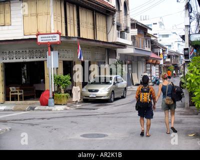 Backpackers walking Hua Hin Thailand - Stock Photo