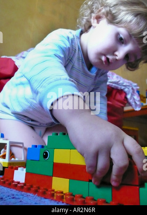 little boy playing with Lego bricks - Stock Photo