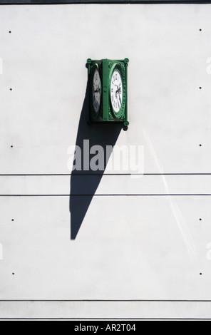 clock on concrete wall - Stock Photo