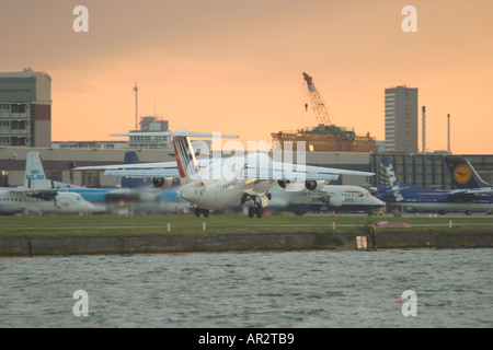 Airplane taking off at London City Airport, UK - Stock Photo