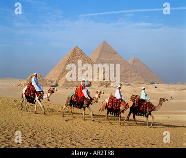Camels and guides in front of the Pyramids at Giza, Cairo, Egypt, North Africa - Stock Photo