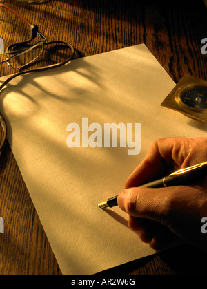 writing letter on parchment paper - Stock Photo
