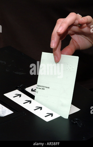 Ballot Box Voting Paper Being Placed into Slot during election. Votes for women - Stock Photo