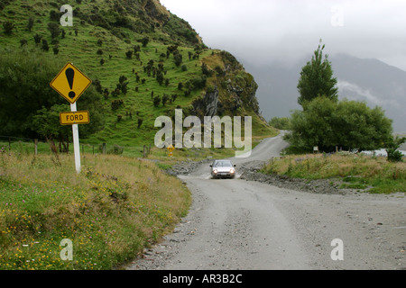 Crossing Ford Mt Aspiring National Park South Island New Zealand - Stock Photo