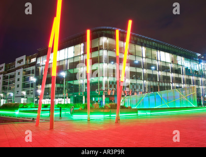 Glass Facade of Modern New Offices at Night Time. Located at Grand Canal Docks in Dublin's Regenerated Docklands - Stock Photo