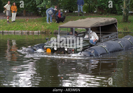 Historic 1963 APGP amphibious Land Rover with flotation bags swimming to commemorate Land Rovers 50th anniversary - Stock Photo