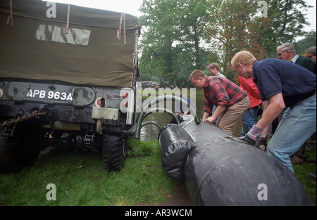 Attaching the flotation bags to a historic 1963 APGP amphibious Land Rover for a swim to commemorate Land Rovers - Stock Photo