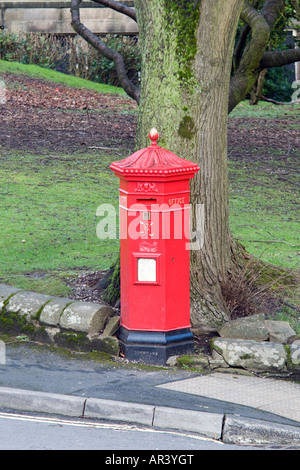 Hexagonal red mail Victorian post box in Buxton Derbyshire 'Great Britain' - Stock Photo