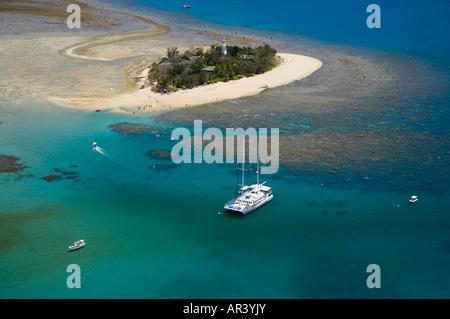 Tourist Boats Low Isles Great Barrier Reef Marine Park near Port Douglas North Queensland Australia aerial - Stock Photo