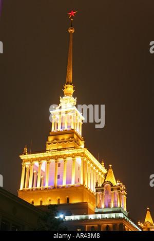 Shanghai Exhibition Center lit at night, Shanghai - Stock Photo