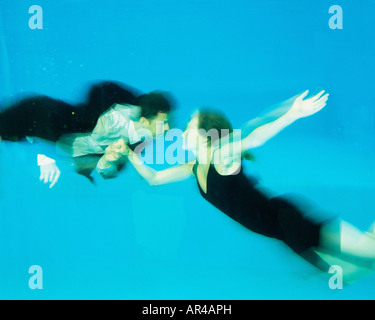 A couple dancing in a swimming pool - Stock Photo