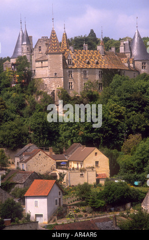 Typical chateau,traditional patterned,tiled roof in Beaune,France,Burgundy,castle with turrets and spires.surrounded - Stock Photo