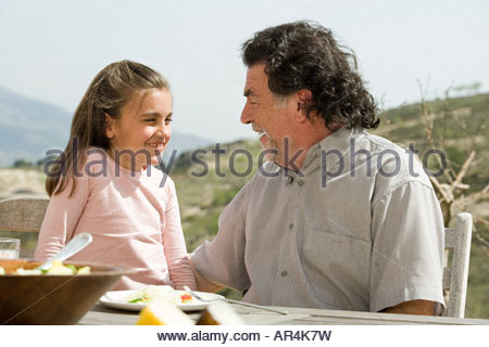 Girl and grandfather - Stock Photo