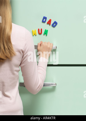 Words written with magnets on refrigerator - Stock Photo
