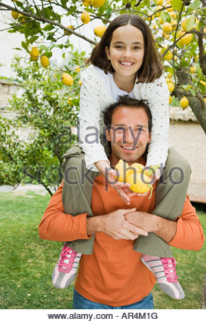 Father shoulder carrying daughter - Stock Photo