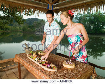 Couple preparing food - Stock Photo