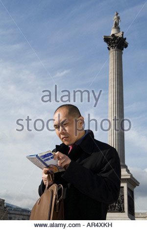 Man looking at map in london - Stock Photo