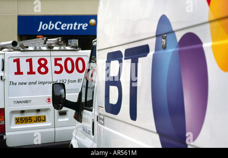 British Telecom utility vans outside a job centre in London's Covent Garden. - Stock Photo