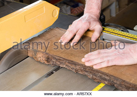 Person using table saw - Stock Photo