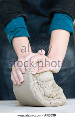 Person working with clay - Stock Photo