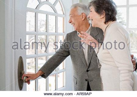 Senior couple waiting for family - Stock Photo