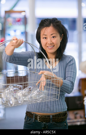 Woman shopping for wine glasses - Stock Photo