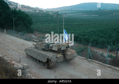 An Israeli Merkava tank patrolling along the border with Lebanon in the town of Metula northern upper Galilee northern - Stock Photo