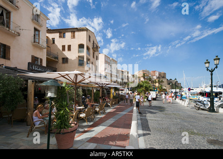 Cafe bar on Quai Landry with the Citadelle in the distance, Harbourfront, Calvi, The Balagne, Corsica, France - Stock Photo
