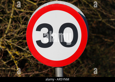 30 mph (Thirty Miles Per Hour) Speed Restriction Sign - Stock Photo