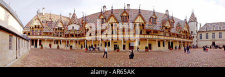 Hotel Dieu in Beaune France It was formerly a hospital Hospices de Beaune with it s famous tiled roof - Stock Photo