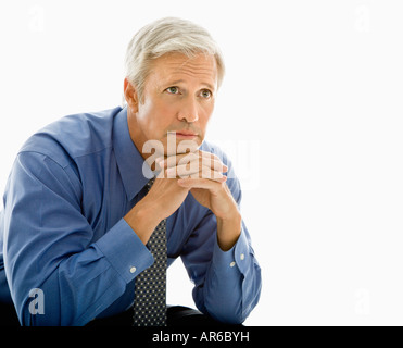 Middle aged Caucasian man with thoughtful expression - Stock Photo