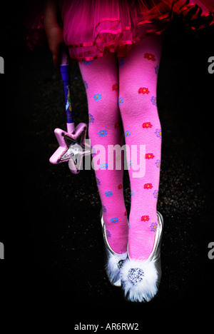 young child fairy ballerina in pink tights, legs only - Stock Photo