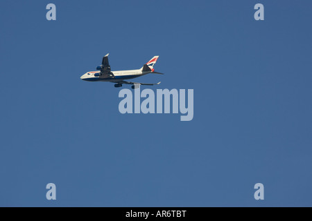 British Airways Boeing 747 Jumbo Jet taking off from Londons Heathrow Airport against a winter blue sky - Stock Photo