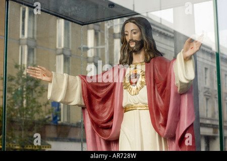 Jesus Christ religious icon behind glass on O'Connell Street in Dublin Ireland - Stock Photo