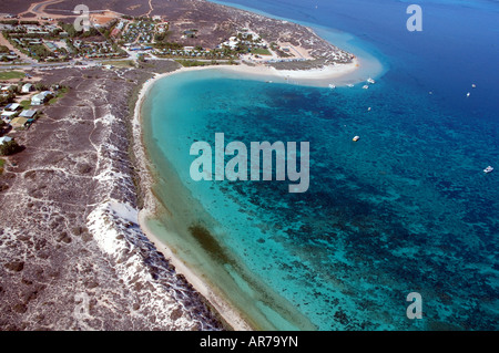 Aerial view of the township boats and reefs of Coral Bay Ningaloo Reef Marine Park Western Australia - Stock Photo