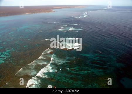Aerial view of reef and coastline of Ningaloo Reef Marine Park Western Australia - Stock Photo