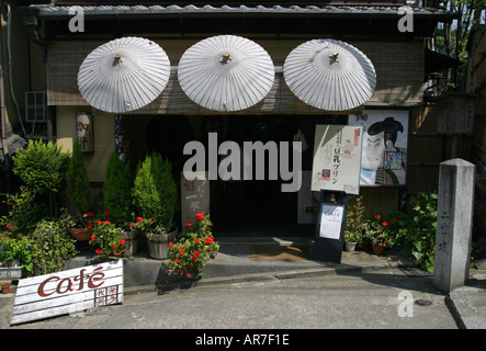 Umbrellas above the entrance to a tourist restaurant in a Kyoto back street Kansai region Japan Asia - Stock Photo