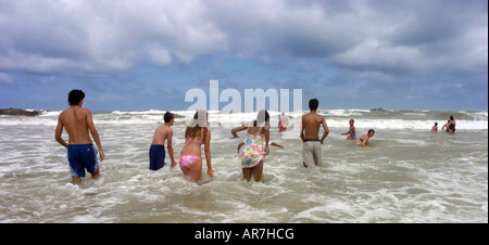 Sri Lanka holiday - Teenagers teens people paddling in the Indian Ocean, Bentota Sri Lanka Asia - Stock Photo