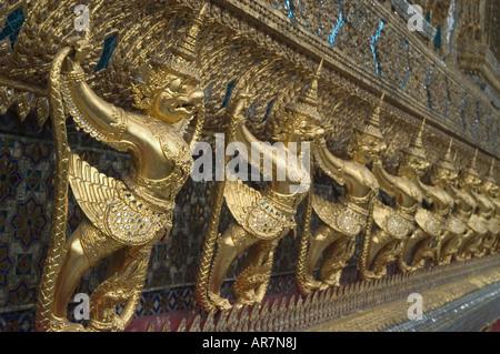 Garuda detail adorning the outer walls of the Temple of the Emerald Buddha, The Grand Royal Palace Bangkok, Thailand - Stock Photo