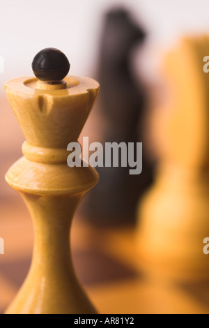 a chess-board with chess-men on it in the middle of a game - Stock Photo