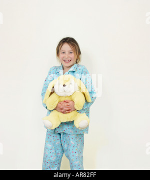 Portrait of a girl holding stuffed toy - Stock Photo