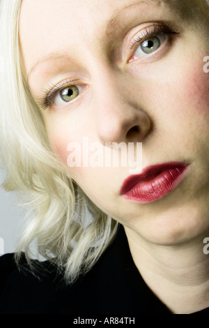 A colour headshot of a blonde woman with blue eyes. - Stock Photo
