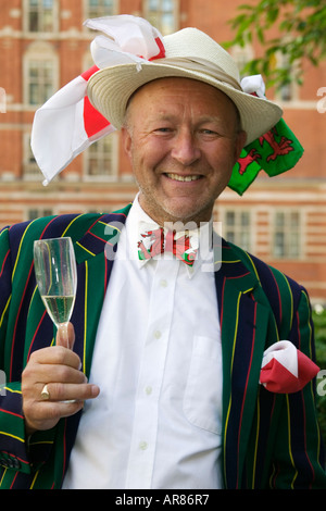 Gentleman with flags on his hat and a glass of champagne at the Last Night of the Proms - Stock Photo