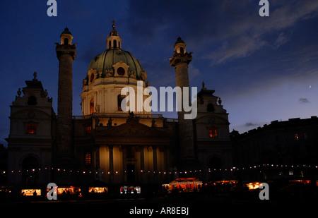 Christmas market stands in front of the Karlskirche (St. Charles' Church) in Vienna, Karlsplatz, Austria, Europe - Stock Photo