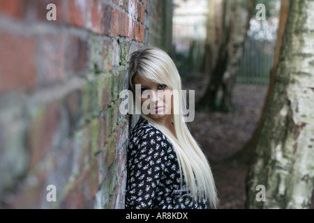 Vicci Goulding, Miss England and Miss UK finalist leaning against a wall - Stock Photo