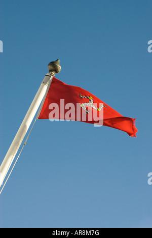 Manx flag flying on flagpole - Stock Photo