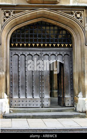Antique Arched Entrance of College in Cambridge England UK - Stock Photo